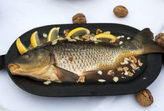 Carp in jelly with lemon, walnuts and almonds Stock Photos