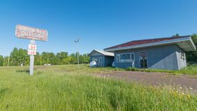 CARP LAKE TOWNSHIP, MICHIGAN / USA - JUNE 16, 2016: Abandoned shut down gas station / convenience store - nature growing back - ru stock images