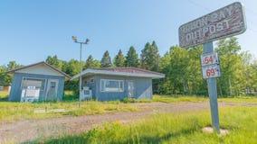 CARP LAKE TOWNSHIP, MICHIGAN / USA - JUNE 16, 2016: Abandoned shut down gas station / convenience store - nature growing back - ru royalty free stock photography
