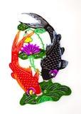 Carp and Lotus. Two carps swimming around lotus flowers and lotus leaf Royalty Free Stock Image