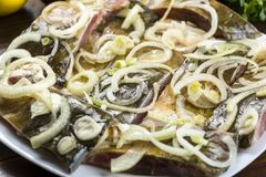Carp marinated in onions Stock Photo
