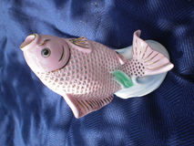 Carp. Pink porcelain figure of fish Royalty Free Stock Images