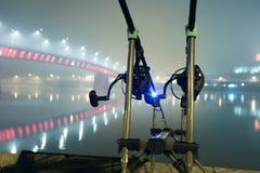 Carp rods in foggy night. Urban Edition. Night Fishing Stock Photo