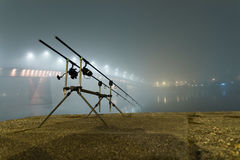 Carp rods in foggy night. Urban Edition. Night Fishing Royalty Free Stock Images