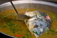 Carp in soup. Carp boiling in a fish soup Royalty Free Stock Images
