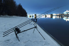 Carp spinning reel angling rods in winter night. Night Fishing Stock Photography