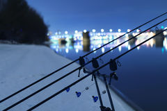 Carp spinning reel angling rods in winter night. Night Fishing. Carp Rods, Winter fishing Stock Photography