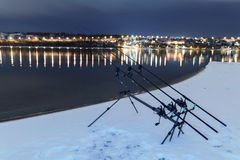 Carp spinning reel angling rods in winter night. Night Fishing. Carp Rods, Winter fishing Stock Images