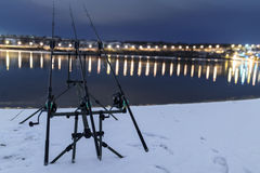 Carp spinning reel angling rods in winter night. Night Fishing. Carp Rods, Winter fishing Royalty Free Stock Photography
