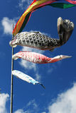 Carp streamers flying in the wind. Blue sky and white clouds in the sky carp swimming Stock Photo