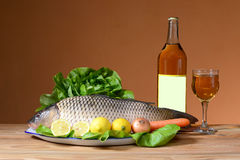 Carp with wine and vegetables Royalty Free Stock Photo