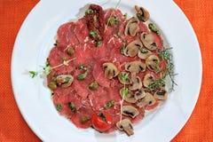 Carpaccio του κρέατος και των μανιταριών Στοκ Εικόνες