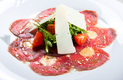 Carpaccio. Meat carpaccio with parmesan cheese, tomatoes and herbs stock images