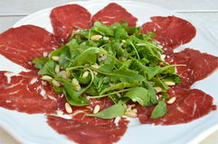 Carpaccio. A plate with Carpaccio and Rucola royalty free stock photography