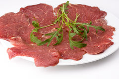 Carpaccio. Beef carpaccio with rocket salad Royalty Free Stock Images