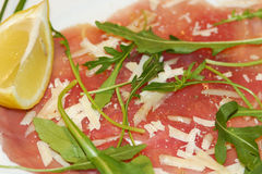 Carpaccio. Close up of beef carpaccio with pepper, rucola and parmesan stock photo