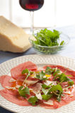 Carpaccio with arugula and parmesan Royalty Free Stock Photo