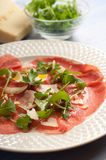 Carpaccio with arugula and parmesan cheese Stock Image