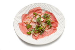 Carpaccio with arugula and parmesan cheese Royalty Free Stock Image