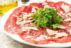 Carpaccio of beef on arugula Royalty Free Stock Photos