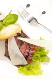 Carpaccio. Beef carpaccio on a table in a restaurant royalty free stock photography