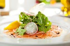 Carpaccio di color salmone Fotografie Stock