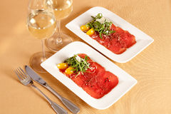 Carpaccio, dish of raw beef meat. Stock Photo
