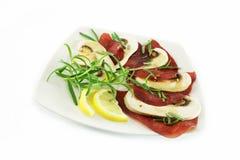 Carpaccio with ham and mushrooms. Carpaccio with  beef ham and raw mushrooms Stock Photo