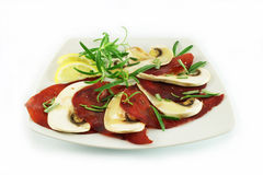 Carpaccio with ham and mushrooms. Carpaccio with beef ham and raw mushrooms Royalty Free Stock Images
