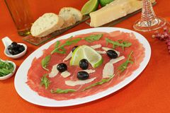 Carpaccio with lime Stock Photo