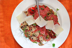 Carpaccio of meat and mushrooms Stock Photography