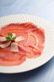 Carpaccio with  parmesan cheese Royalty Free Stock Photos
