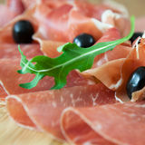 Carpaccio and prosciutto with olives Stock Photography