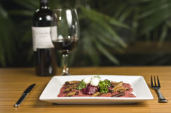 Carpaccio and red wine Stock Image