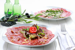 Carpaccio with salad and pine nut Royalty Free Stock Images