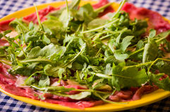Carpaccio. Tipical italian food. Beef, rucola and parmigiano Royalty Free Stock Photography