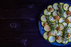 Carpaccio of zucchini with nuts and cheese royalty free stock image