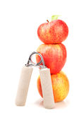 Carpal expander and a stack of three red apples Royalty Free Stock Image