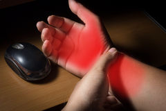 Carpal tunnel syndrome,wrist pain. From working with computer royalty free stock photo