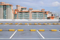Carpark and high rise buildings. The topmost level of the carpark against buildings in the background Royalty Free Stock Image