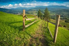 Carpathian alpine village with spring grass Royalty Free Stock Photos