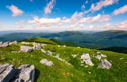Carpathian alps with huge boulders on hillsides. Carpathian alps with huge boulders on hilles. beautiful summer landscape in fine weather. Location Polonina Runa Royalty Free Stock Image
