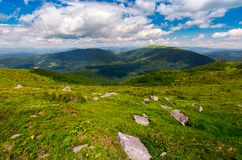 Carpathian alps with huge boulders on hillsides. Beautiful summer landscape on overcast day. Location Polonina Runa, Ukraine Stock Images