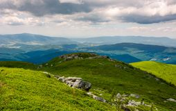 Carpathian alps with huge boulders on hillsides. Carpathian alps with huge boulders on hilles. beautiful summer landscape on overcast day. Location Polonina Runa Royalty Free Stock Image