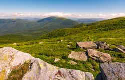 Carpathian alps with huge boulders on hillsides. Carpathian alps with huge boulders on hilles. beautiful summer landscape in fine weather. Location Polonina Runa Stock Photo