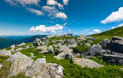 Carpathian alps with huge boulders on hillsides. Beautiful summer landscape in fine weather. Location Polonina Runa, Ukraine Royalty Free Stock Photo