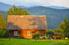 Carpathian house. Life mountain live background landscape grass sunlight sunset sky view nature Royalty Free Stock Photo