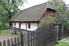 Carpathian house. Carpathian old house behind the fence  in the open-air museum in Ukraine Royalty Free Stock Photography