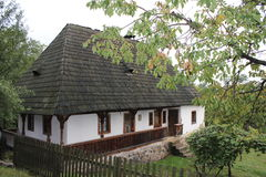 Carpathian house. Carpathian old house behind the fence in the open-air museum in Ukraine royalty free stock photos