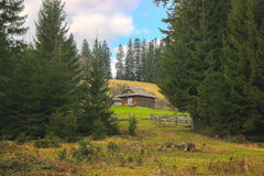Carpathian hut at mountains. Panoramic views of the beautiful landscape an hut in the Carpathian mountains Stock Photography